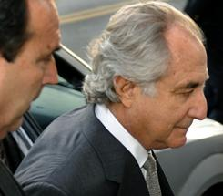 Wall Street financier Bernard Madoff (right) arrives at a federal court in this March 12, 2009 photo in New York.