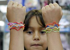 Isabella Marino shows off her silly bandz in a store in Hollywood, Fla., on Wednesday, May 12, 2010.