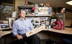 EBay CEO John Donahoe at his office  a cubicle  with some items he's purchased on eBay.
