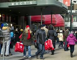 Shoppers make their way through Herald Square near Macy's Dec. 17, 2010 in New York.