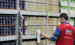 A Lowe's employee checks inventory of paint during the grand opening of the Lowe's store on Nov. 4, 2010, in San Francisco.