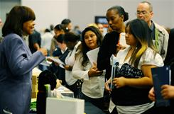 Job seekers listen to a career counselor at Choice Career Fair at the Los Angeles Convention Center on Dec. 1, 2010.