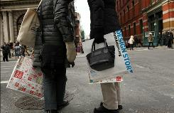Shoppers walk down Broadway in New York City.