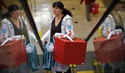 Angelica Vargas of La Habra, Calif., shops at Brea Mall in Brea, Calif., the day after Christmas.