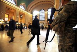 National Guard security personnel stand guard as travelers make their way through Grand Central Station in New York City in November.