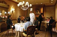 Executive Chef Scott Hunnel visits guests table side at Victoria and Albert's restaurant at Disney's Grand Floridian Resort & Spa in Orlando.