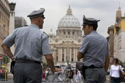In this Sept. 21, 2010, file photo, Italian financial police officers talk to each other in front of St. Peter's square at the Vatican.