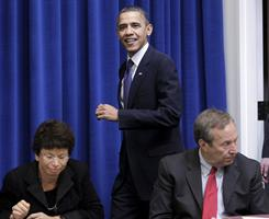 President Obama arrives for a meeting with the President's Export Council on Dec. 9, 2010, in the Executive Office Building. White House Senior Adviser Valerie Jarrett is seated left, and National Economic Council Director Lawrence Summers is seated at right.