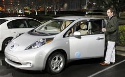 Jeff Heeren gets into his Nissan Leaf electric car Dec. 29, 2010, in Nashville
