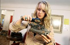 "Antiques dealer Cari Cucksey, of HGTV's new series ""Cash & Cari,"" examines a pre-World War II American Flyer miniature train engine."
