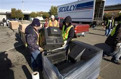 Universal Waste Management employees unload CRT monitors and other electronic waste during a free recyling event in the parking lot of the DMV in El Cerrito, Calif., in January 2009.