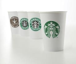 Starbucks' latest logo is seen on the cup at right. Other cups show the company's logo from over the years, from left, 1971, 1987, and 1992.
