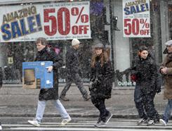 Shoppers make their way in the snow in New York in this file photo. Retailers reported healthy growth in January.