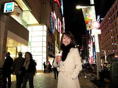 "An influx of Chinese shoppers is ""good for Japan,"" says Tokyo resident Ayako Takahashi, 26, seen here in Tokyo's luxury Ginza district."