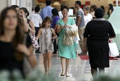 Shoppers walk at a mall in Brasilia on Dec. 10. Stocks in Brazil gained 6.2% in 2010.