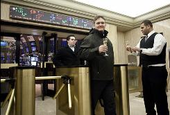 Traders are offered Champagne in anticipation of the New Year as they leave the New York Stock Exchange at the end of trading on Dec. 31.