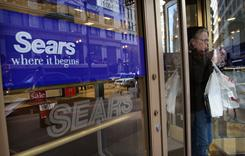A customer leaves a Sears store in Chicago in this file photo.
