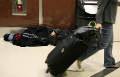 Steven Roberts naps Monday at Atlanta Hartsfield-Jackson International Airport.
