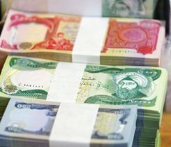 Iraqi dinars sit in a bank in Tikrit, Iraq.
