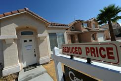 A reduced-price home has a foreclosure notice taped to the front door in the Spring Valley area in Las Vegas on Oct. 15, 2010.