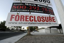 A foreclosure sign is seen in front of a bank-owned home for sale in Las Vegas in November 2010. Foreclosures have dipped in the last two months. 