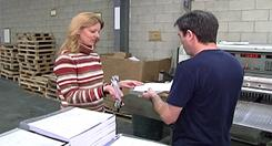 Patrick Karchur receives his first paycheck of 2011 at Perfect Printing near Philadelphia.