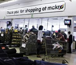 Customers make their way to the tills at a MAKRO megastore on the outskirts of Cape Town, South Africa in this file photo. Makro is one of the brands of South African giant retailer Massmart.