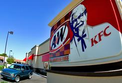 A car makes it way through the drive-thru at a KFC/A&W restaurant in Tempe, Ariz. in this file photo.
