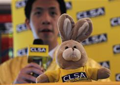 Analyst Philip Chow speaks behind a toy rabbit during a press conference as CLSA Asia-Pacific Markets released its annual feng shui index in Hong Kong on Jan. 19, 2011.