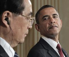 President Obama and China's President Hu Jintao at a White House appearance on Wednesday.
