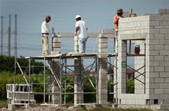 Construction workers are seen building a new home on Oct. 19, 2010 in Cooper City, Fla.