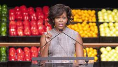 Michelle Obama takes part in Wal-Mart's announcement of its effort to offer customers healthier and more affordable food. 