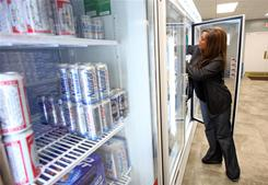 Store manager Amber Nabors stocks shelves at The 1st Package Store in Fayette, Ala. on Jan. 11, 2011.