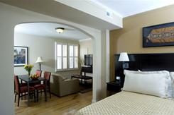 A suite at the Best Western Plus Hawthorne Terrace Hotel in Chicago features two bedrooms, each with a double bed, desk, armoire and flat-panel TV.