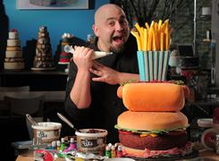 Duff Goldman, of Aces of Cakes fame, demonstrates products at Charm City Cakes in Baltimore. He has a co-branding deal with Gartner Studios for baking and decorating products.