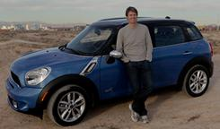 Pandora founder Tim Westergren stands in the Nevada desert with a Mini that features the add-on that lets the driver plug in a smartphone to access Internet apps.