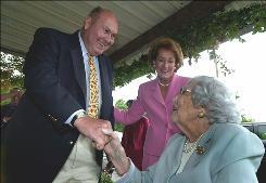 In this file photo, Willard Scott greets then-Sen. Elizabeth Dole's 100-year-old mom in N.C.