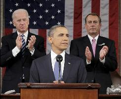 President Obama gives his State of the Union speech on Tuesday flanked by Vice President Biden, left, and House Speaker John Boehner.