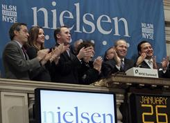 Nielsen CEO David Calhoun applauds with company officials during opening bell ceremonies for the Nielsen IPO at the New York Stock Exchange on Wednesday, Jan. 26, 2011. 