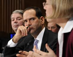 Neil Barofsky, center, inspector general over the government's bank bailout plan, listens at a Senate Banking Committee hearing in 2009.