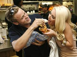Spencer Pratt and Heidi Montag of MTV's &quot;The Hills&quot; pose for pictures at a Taco Bell restaurant in Los Angeles to help raise awareness and funds for World Hunger Relief Week on Oct. 2, 2008. 