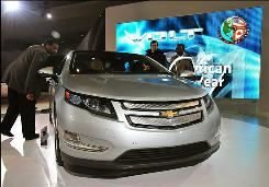 Media members examine the 2011 Chevrolet Volt at the Washington Auto Show on Thursday.