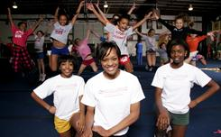 Brittany Rose, center, CEO of More Than Cheer, with assistants Desire Branch-Ellis, left, and Jenne Nurse, right. Rose, 22, started the business when she was a marketing major in college.