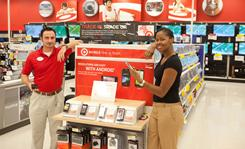 Essence Goodwin, right, Target Manhattan Beach, Calif., mobile manager, and Rob Mezher, a senior Target team leader. Consumers can trade in tech gear for new goods or store credit at Target.