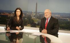 Ghida Fakhry and her former co-anchor Dave Marash on the set of the English-speaking arm of Al Jazeera television.
