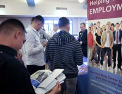 Job fair: Active duty Marines read brochures on various careers during a law enforcement and security job fair in San Diego on Wednesday.