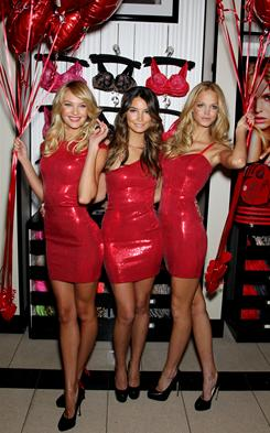 Models Candice Swanepoel, from left, Erin Heatherton and Lily Aldridge in a Valentine's Day promotion at a Victoria's Secret store.