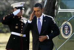 President Obama salutes a Marine as he returns Monday to the White House from Baltimore.