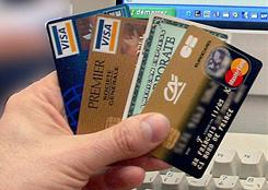 A man in Lille, France holds several credit cards in this file photo.