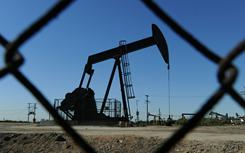An oilfield near central Los Angeles is seen through a fence. World oil prices have been rising on Mideast unrest.